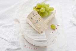 Blue cheese with green grapes