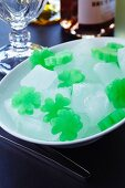 A bowl of clover leaf-shaped ice cubes