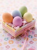 An Easter parcel with brightly coloured eggs for Easter