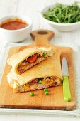 Calzone with ham, cheese, peppers and peas