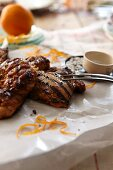 Barbecued chicken with garlic, fennel and oranges