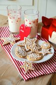 Christmas biscuits, milk and a Christmas present