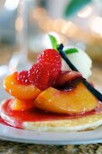 Pancakes with peaches, raspberries and lemongrass (close-up)