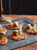 Mini mushroom pizzas for Halloween