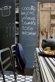 A blackboard with writing on in a rustic kitchen