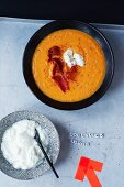 Carrot soup with bresaola and sour cream