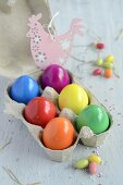 Colourful Easter eggs in an egg box
