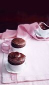 Two hot chocolate souffles in dishes