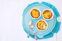 Chilled lemon puddings with toffee crust