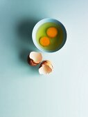 Two shelled eggs in a bowl