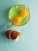 Two raw eggs in a measuring jug