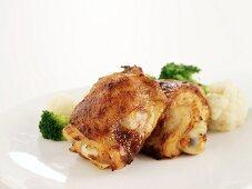 Chicken legs with cauliflower and broccoli