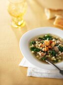 Pasta soup with sausage and croutons