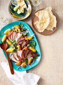 Spicy chicken salad with peach and onion