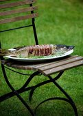 Barbecued pike wrapped in bacon