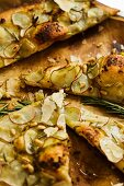 Sliced Thin Crust Potato Rosemary Pizza with Pine Nuts