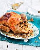 Roast turkey stuffed with almonds, sage and bacon