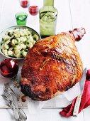 Roast leg of pork with an orange glaze and a potato and parsley salad