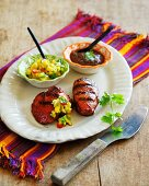Barbecued pork medallions with two different sauces