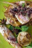 Red mullet with olives, mint, star anise and a baked onion