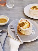 Meringue roulade with lime mascarpone and passion fruit sauce