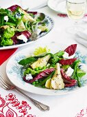 Vegetables salad made with asparagus, artichokes, peas and goat's cheese