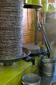Olive oil being pressed out of baskets of crushed olives (Tunisia)