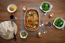 Stuffed chicken with vegetables in a clay pot, with savoy cabbage, white bread and mostarda di frutta (Italian condiment made of candied fruit and a mustard flavoured syrup)