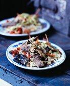 Japchae (fried glass noddles, Korea) with mushrooms and beef