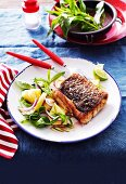 Grilled Australian barramundi fillet served with pineapple salad with basil and mint