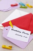 Invitation card with envelope and clothes peg