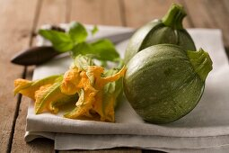 Round courgettes and courgette flowers