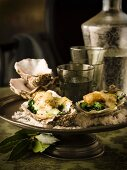 Oysters Rockefeller (oysters with spinach, topped with sauce and baked)
