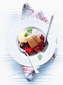 Berry pudding with vanilla ice cream