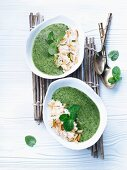 Spinach and coconut soup with pine nuts
