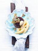 Mini Amarula and chocolate cake with fruit, vanilla sauce and caramel