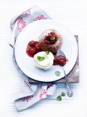 Individual baked chocolate pudding with cherries
