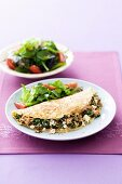 An omelette filled with tuna, spinach and feta