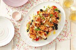 Mediterranean rice salad with pieces of fried chicken