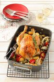 Thyme chicken on a bed of vegetables