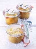 Small apple cakes, baked in jars
