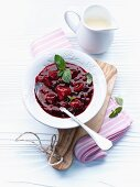 Red berry compote with mint leaves