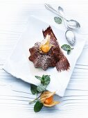 Walnut and chocolate pudding with physalis