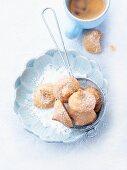 Amarettini with icing sugar and espresso