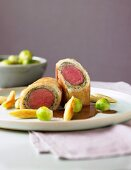 Saddle of venison in pastry crust with Brussels sprouts and potato dumplings