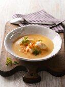 Potato soup with fish dumplings