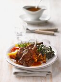 Lamb cutlets with roast potatoes and vegetables