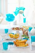 A table set for a party with assorted nibbles
