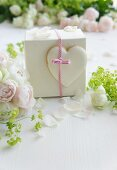 A little gift decorated with a heart-shaped biscuit