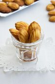 Madeleines in a glass on a doily as a gift